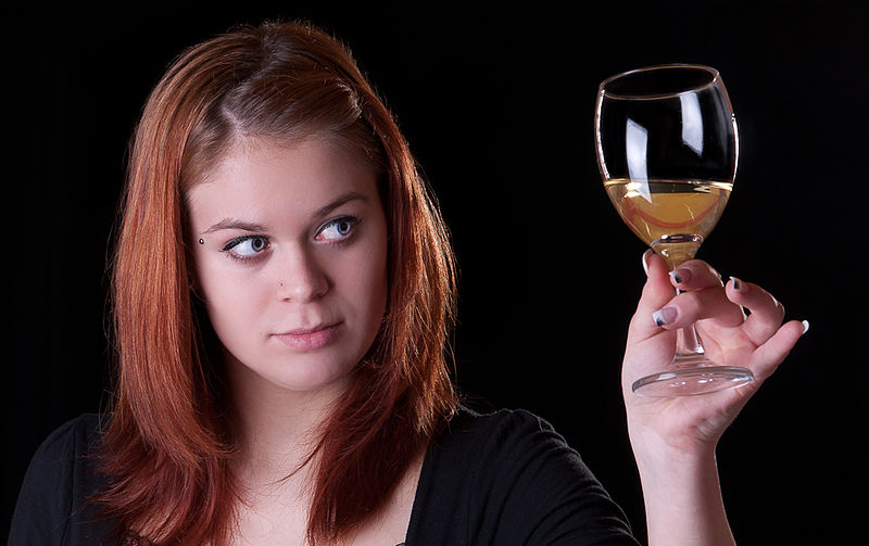Girl with a glass of wine